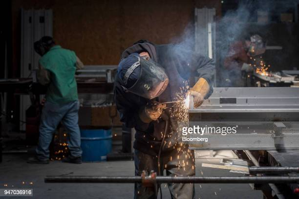 A worker arc welds seams on a metal door at the Metal Manufacturing Co facility in Sacramento California US on Thursday April 12 2018 The Federal...