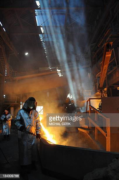 Worker are pictured on May 31 2011 in Ostrava at a steel and iron factory in Mittal Steelworks Czech Republic's third largest city of Ostravaabout...