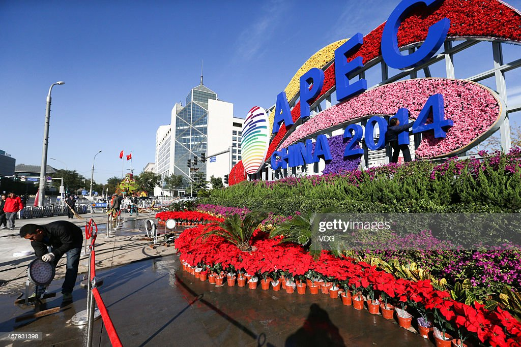 A worker arranges flower terrace to welcome Asia-Pacific Economic Cooperation (APEC) at Changan Avenue on October 26, 2014 in Beijing, China. Flowers in the themes of 'Harmony and Win-win Result' and 'Peaceful Development' were arranged at Changan Avenue for the upcoming APEC summit on Thursday in Beijing.