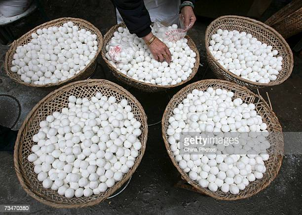 A worker arranges tangyuan or yuanxiao traditional food for the Lantern Festival in the Confucius Temple district March 2 2007 in Nanjing of Jiangsu...