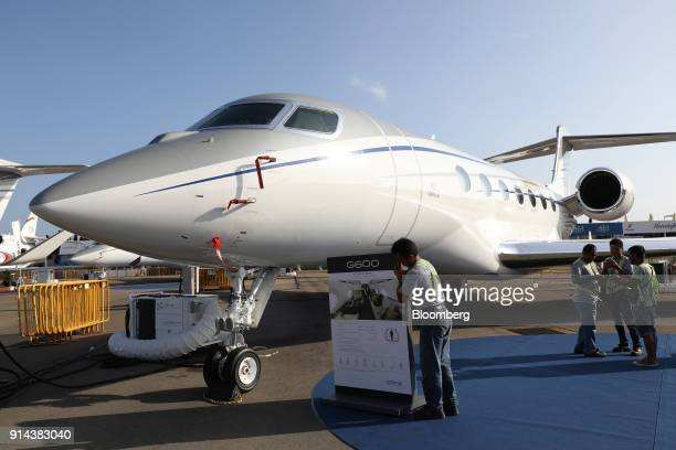 A worker arranges the sign for the G600 business jet manufactured by Gulfstream Aerospace Corp a unit of General Dynamics Corp at the Singapore...
