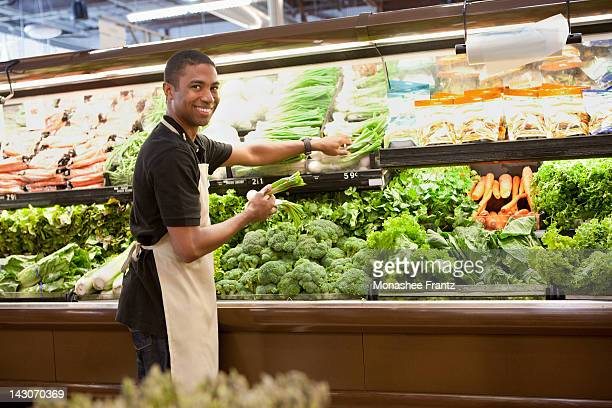 worker arranging produce in supermarket - men wearing stockings stock photos and pictures