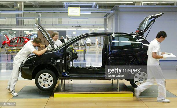 Worker assemble a Volkswagen Polo compact car October 29, 2003 at the Volkswagen factory just outside Bratislava, Slovakia. The factory produces the...