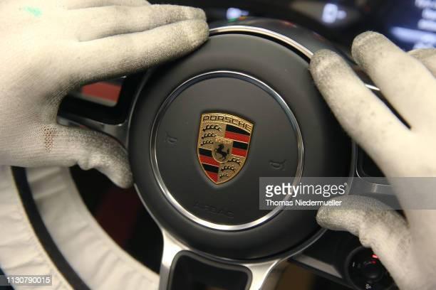 Worker assemble Porsche cars on an assembly line at the Porsche plant in Zuffenhausen district on February 19, 2019 in Stuttgart, Germany. European...