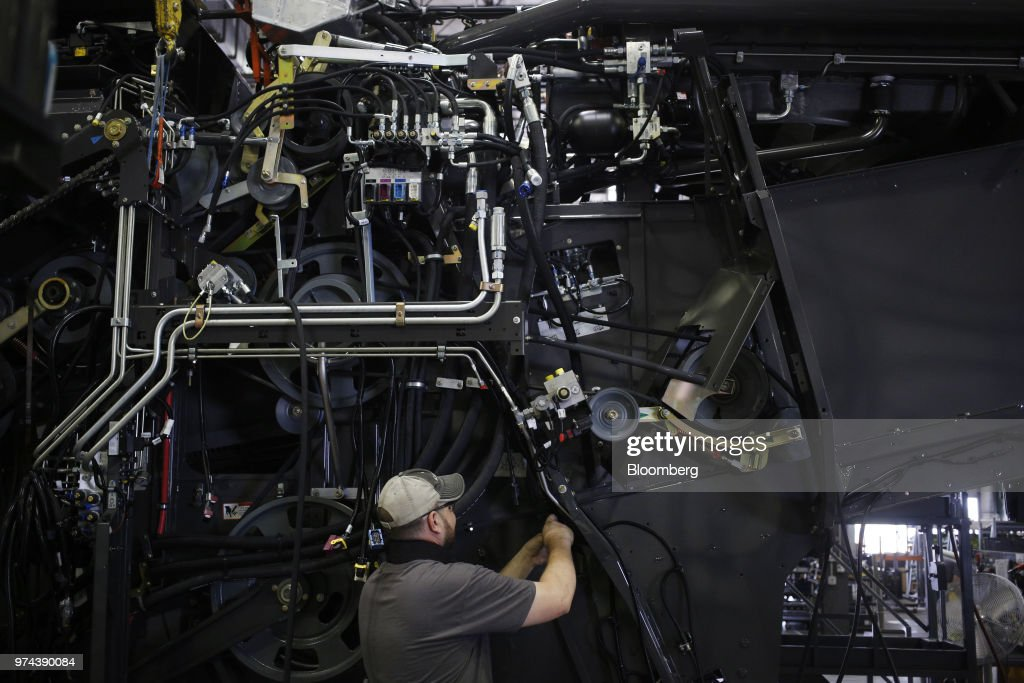 A worker assembles a combine harvester at the CLAAS of America Inc. production facility in Omaha, Nebraska, U.S., on Wednesday, June 6, 2018. The Federal Reserve is scheduled to release industrial production figures on June 15. Photographer: Luke Sharrett/Bloomberg via Getty Images