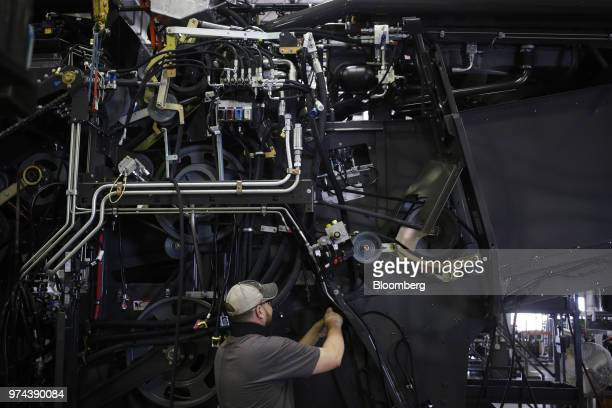 A worker assembles a combine harvester at the CLAAS of America Inc production facility in Omaha Nebraska US on Wednesday June 6 2018 The Federal...