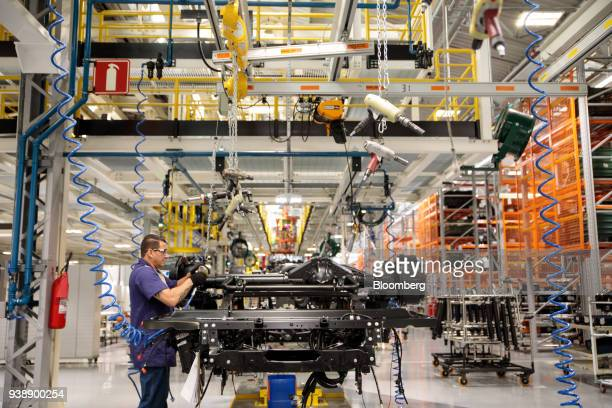 A worker assembles a Daimler AG MercedesBenz truck on the new production line at the company's factory in Sao Bernardo do Campo Sao Paulo state...