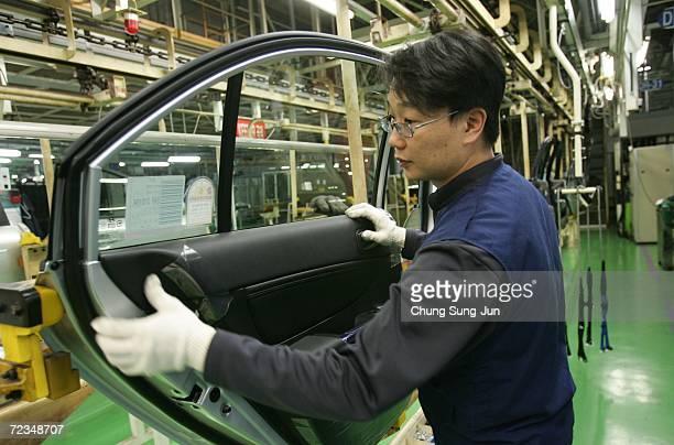 A worker assembles a Hyundai vehicle at the Asan plant on November 2 2006 in Asan South Korea Hyundai Motors Co on November 1 cited extended public...