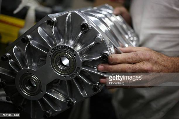 A worker assembles a supercharger on the factory floor at the Holley Performance Products Inc manufacturing facility in Bowling Green Kentucky US on...
