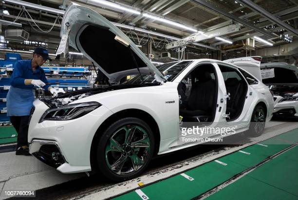 Worker assembles a Toyota Motor Corp Crown vehicle on the production line of the company's Motomachi factory on July 30, 2018 in Toyota, Japan....