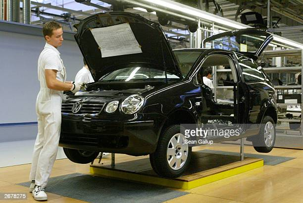 Worker assembles a Volkswagen Polo compact car October 29, 2003 at the Volkswagen factory just outside Bratislava, Slovakia. The factory produces the...