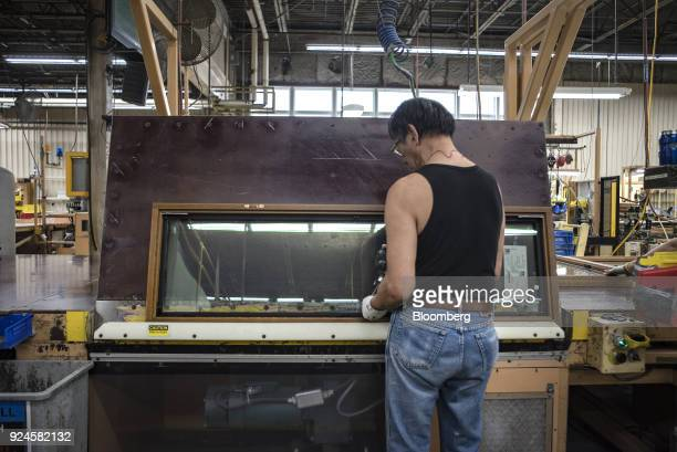 A worker assembles a window frame at the Pella Corp manufacturing facility in Pella Iowa US on Thursday Feb 22 2018 The US Census Bureau is scheduled...
