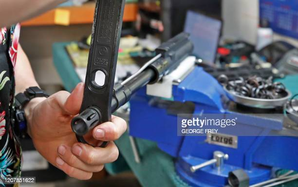 A worker assembles an AR15 rifle at Delta Team Tactical in Orem Utah on March 20 2020 Gun stores in the US are reporting a surge in sales of firearms...