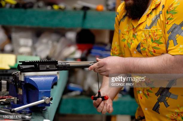 A worker assembles an AR15 rifles at Delta Team Tactical in Orem Utah on March 20 2020 Gun stores in the US are reporting a surge in sales of...