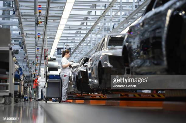 A worker assembles Audi sedans on an assembly line at the Audi automobile plant on March 14 2018 in Ingolstadt Germany US President Donald Trump has...