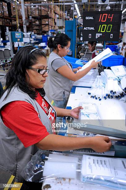 A worker assembles medical accessories at the DJO Global plant in Tijuana Mexico on Monday Oct 11 2010 Production at Mexican export factories known...