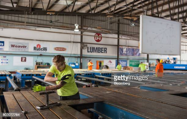 a worker assembles roof trusses at the 84 lumber co california truss plant in coal center - 84 Lumber Roof Trusses