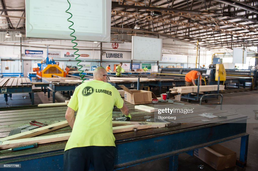 a worker assembles roof trusses at the 84 lumber co california truss plant in coal - 84 Lumber Roof Trusses