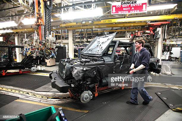 Worker assembles the 2014 Jeep Wrangler at the Chrysler Toledo North Assembly Plant Jeep May 7, 2014 in Toledo, Ohio. Fiat Chrysler Automobiles...