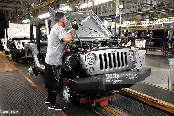 A worker assembles the 2014 Jeep Wrangler at the Chrysler Toledo North Assembly Plant Jeep May 7 2014 in Toledo Ohio Fiat Chrysler Automobiles...