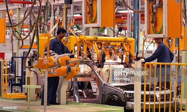 A worker assembles the body of a Mahindra Logan a new car launched by Renault SA and Mahindra Mahindra Ltd in Nashik India on Wednesday April 4 2007...