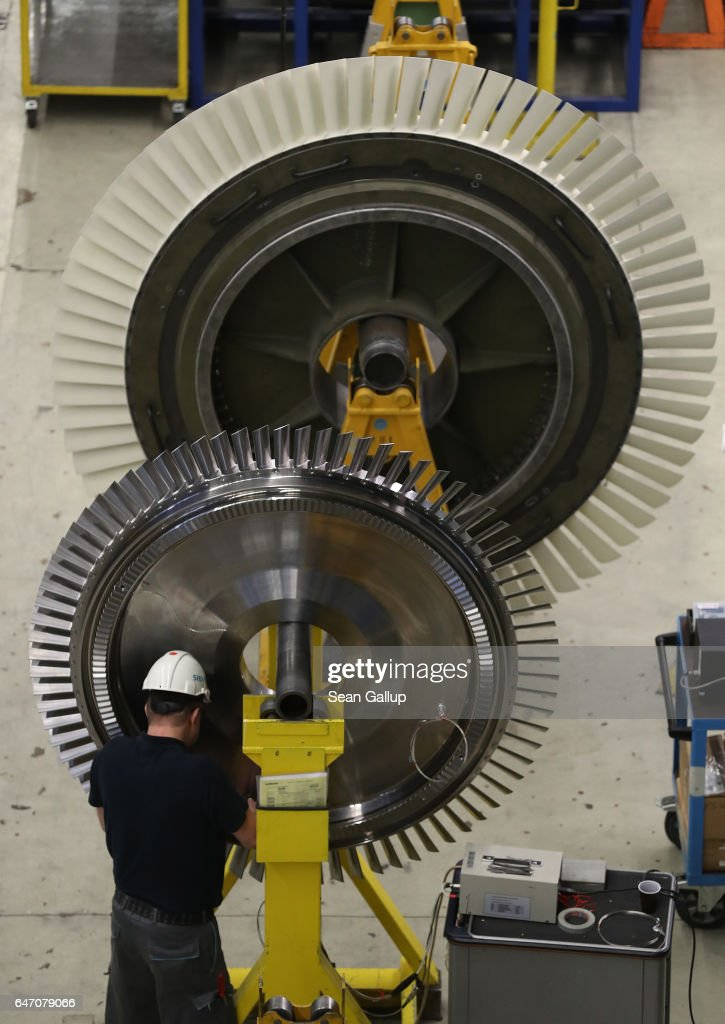 A worker assembles turbine components at the Siemens gas