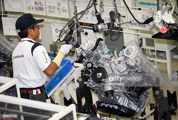 A worker assembles V8 engines of Toyota Motor Corp's luxury series Lexus LS600 hybrid sedan on the production line at its Tahara plant in Tahara...