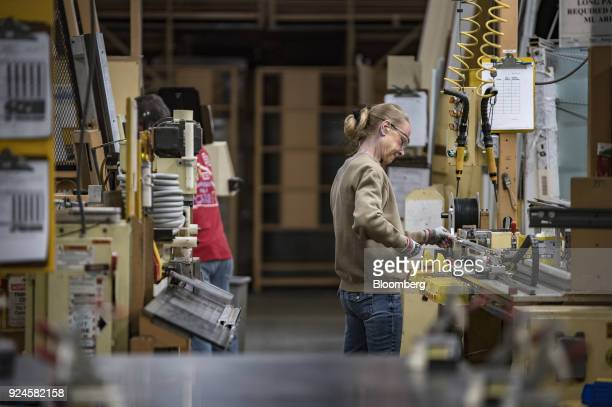A worker assembles window frames at the Pella Corp manufacturing facility in Pella Iowa US on Thursday Feb 22 2018 The US Census Bureau is scheduled...