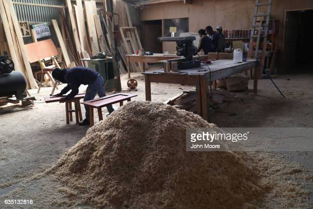 A worker at a carpentry cooperative makes furnature on February 11 2017 in the western highlands town of Cajola Guatemala Some 70 percent of the men...