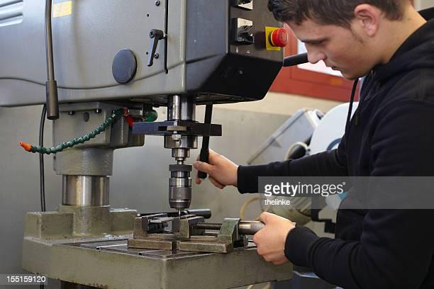 worker at a drill - locksmith stockfoto's en -beelden