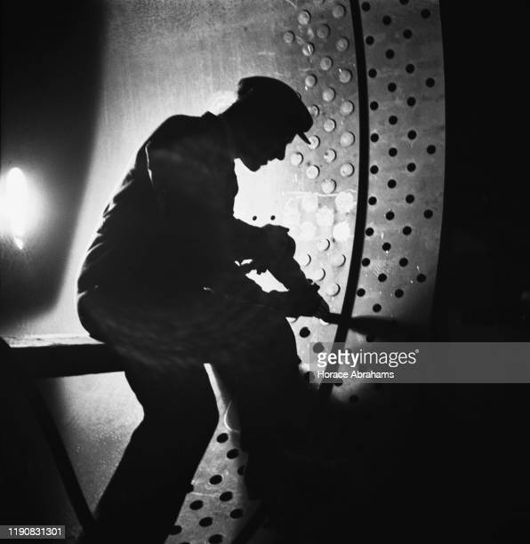 Worker at a steel foundry in the UK during World War II, April 1941.