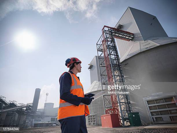 Worker at biomass storage facility
