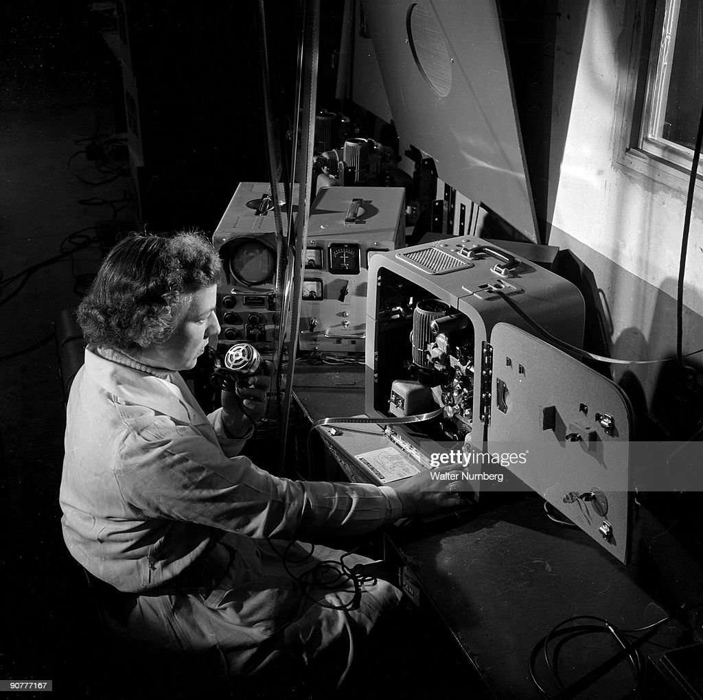 A female worker testssound projector, Mitcheldean, 1956. : News Photo