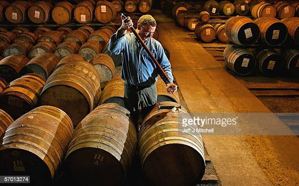 A worker at Bruichladdich distillery takes a whisky sample from a cask March 6 Bruichladdich in Islay Bruichladdich will use an ancient recipe to...
