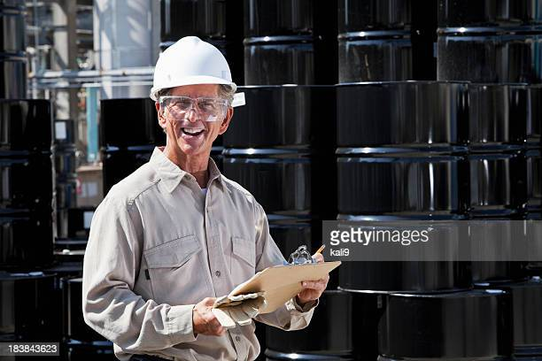 worker at chemical plant - steel drum stock photos and pictures