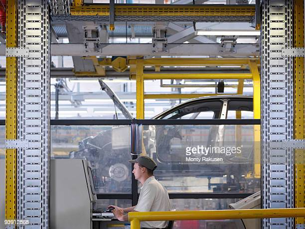 Worker At Controls On Production Line