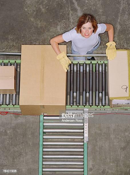 Worker at conveyor belt