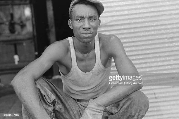 Worker at Cotton Gin Lehi Arkansas USA Russell Lee September 1938