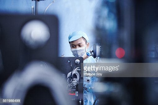 Worker at e-cigarettes battery factory, Guangdong, China