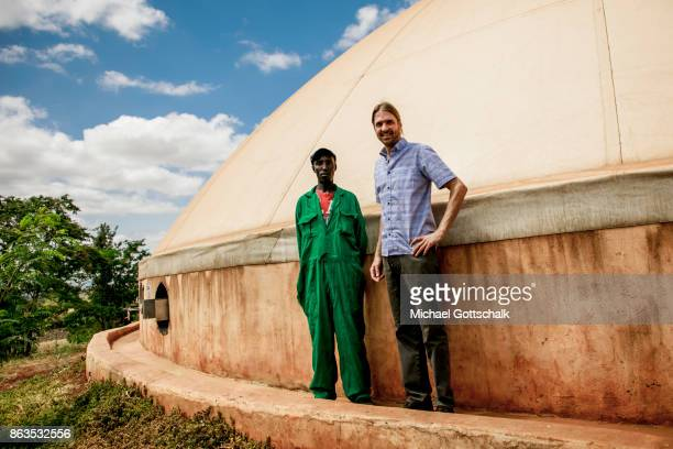 A worker at environmentally friendly and renewable energy bio gas generation in the Thika area at an avocado oil mill of Olivado company on October...
