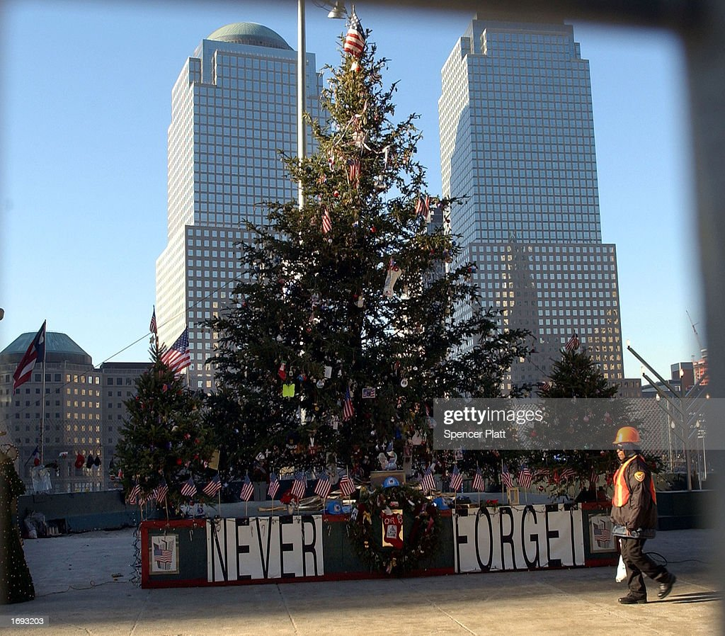 Christmas At Ground Zero.A Worker At Ground Zero Walks Past A Christmas Tree December