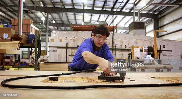 A worker at Jayco Inc the country's third largest maker of recreational vehicles builds wall panels for a Jay Flight travel trailer February 10 2009...