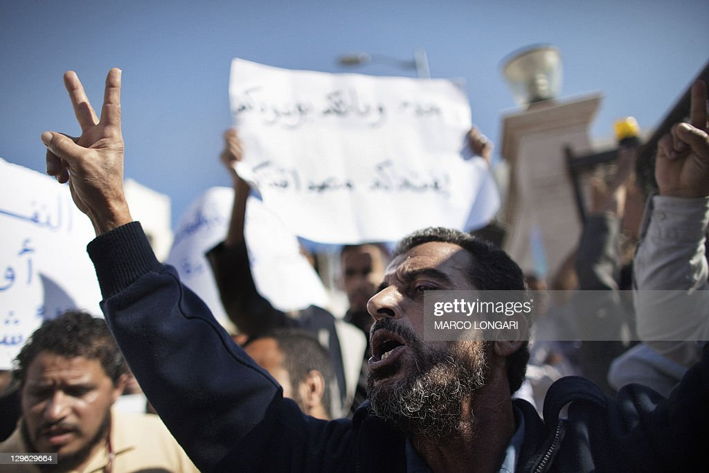 A worker at Libya's Waha Oil Company shouts slogans during a