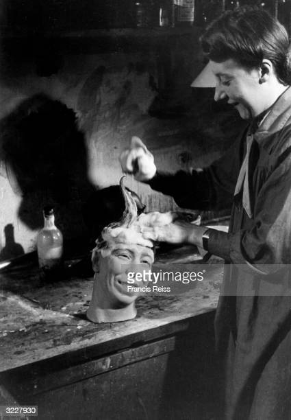 A worker at Madame Tussaud's waxwork museum gives George Formby's head a good shampooing Original Publication Picture Post 1973 Madame Tussauds unpub
