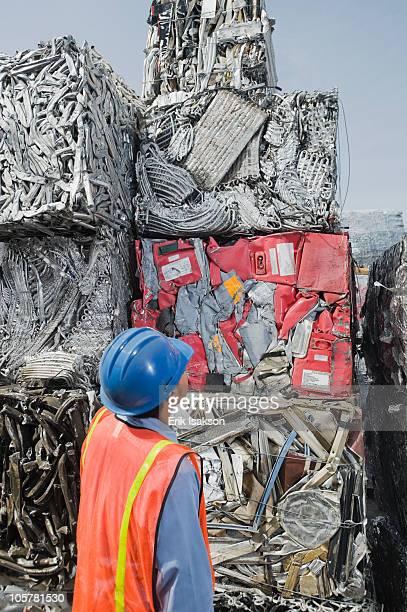 worker at recycling plant - aluhut stock-fotos und bilder