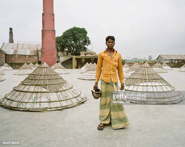 worker at rice processing plant - traditional clothing stock pictures, royalty-free photos & images