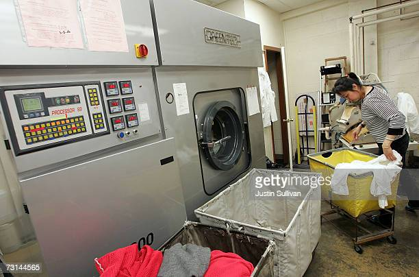 A worker at Sohn's French Cleaners sorts clothes next to a Greentech dry clean machine that uses ecofriendly chemicals January 29 2007 in San...