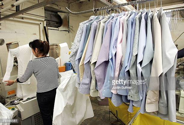 A worker at Sohn's French Cleaners which uses ecofriendly chemicals to dry clean clothes presses shirts January 29 2007 in San Francisco California...