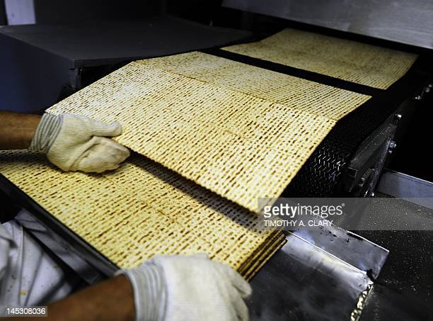A worker at Streit's Matzo factory on the lower east side of New York prepares matzo wafers on May 9 2012 Aron Streit Inc is a kosher food company...