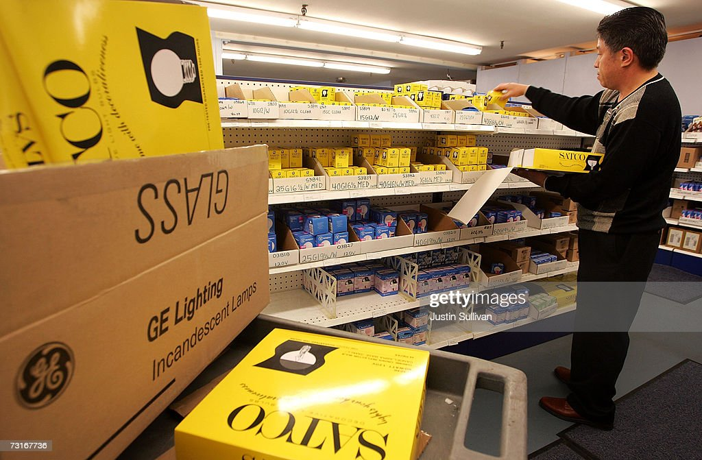 A Worker At The City Lights Light Bulb Store Stocks Shelves With  Incandescent Light Bulbs January